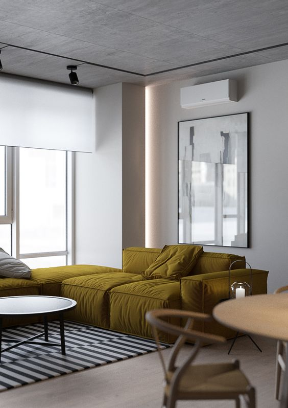 a modern corner sofa in mustard adds interest and color to this monochrome space in black and white