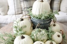 10 a basket with white pumpkins, fresh greenery is great for a neutral fall space