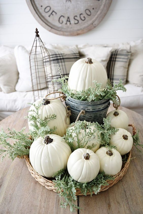 a basket with white pumpkins, fresh greenery is great for a neutral fall space