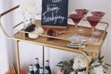 11 a fall bar cart with faux pumpkins, white flower arrangements and pinecones plus chalkboards