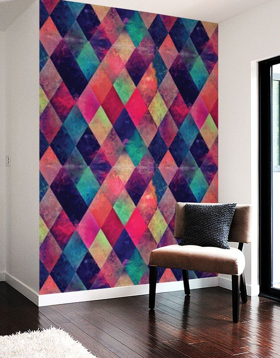 a very bold and colroful geometric accent wall done with wall decals