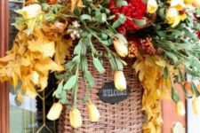 12 a basket with fall leaves, berries, bloos, greenery and flowers is a great door decoration instead of a wreath