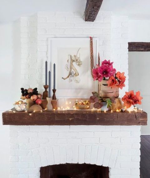 a modern bold idea with LEDs, bright blooms, fruits and candles in candle holders