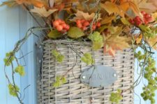 13 a basket with fall leaves, cascading greenery and berries can be used instead of a usual fall wreath