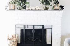 13 a modern mantel with eucalyptus branches in sheer vases, lanterns and white pumpkins