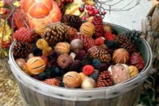 14 a bushel basket filled with colorful pinecones, citrus and nuts is great for outdoor decor
