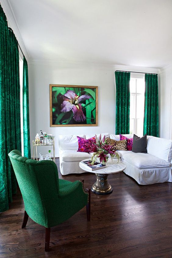 hang bold emerald curtains in your neutral space to make a bright statement