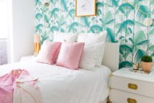 15 bring a glam tropical touch with a palm leaf accent wall like this one