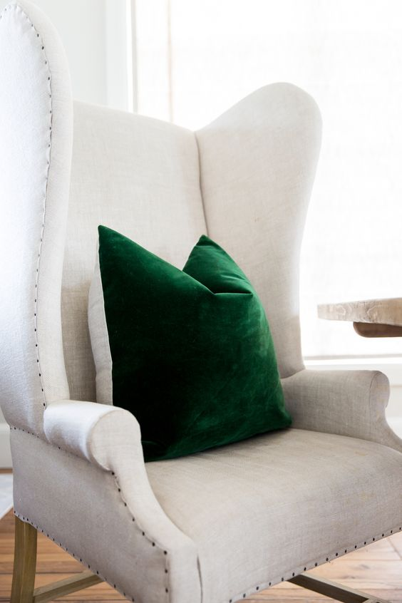 spruce up your neutral chair with a super bold emerald pillow of velvet