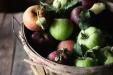 16 display fresh apples in a bushel basket and you'll get decor and food at the same time