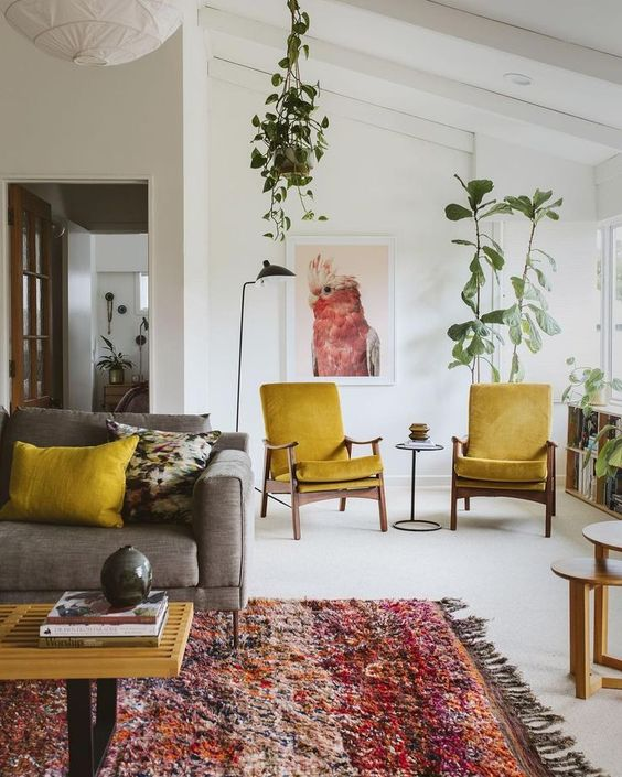 mid century modern mustard chairs and a matching pillow to infuse the living room with color