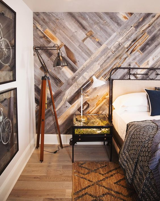 weathered wood accent wall with a geometric pattern for a warm rustic feel in the space