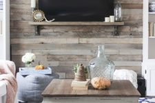 17 a wood accent wall is a good option for a rustic meets shabby chic space like this one