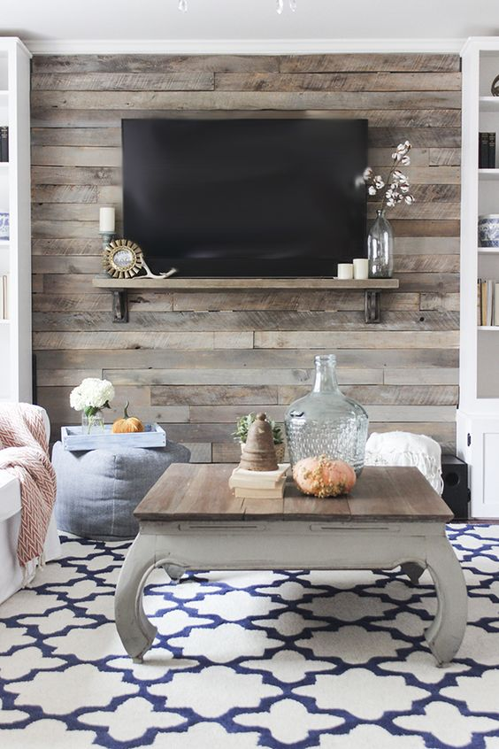 a wood accent wall is a good option for a rustic meets shabby chic space like this one