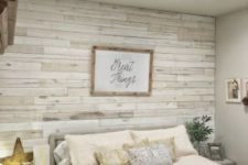 19 a whitewashed weathered wood accent wall for a coastal shabby chic bedroom