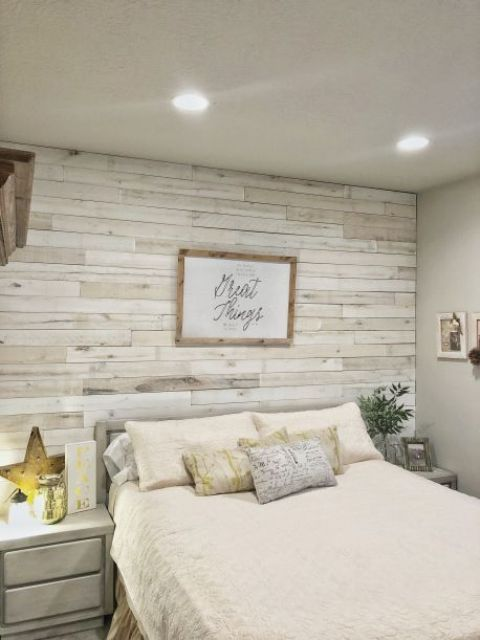 a whitewashed weathered wood accent wall for a coastal shabby chic bedroom