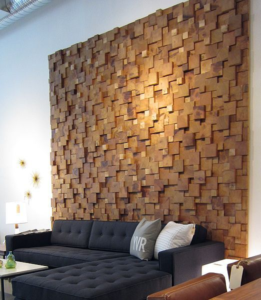 a creative textural and dimensional wood piece accent wall is an ultra-modenr yet comforting idea