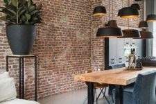 23 a bold red brick accent wall adds an industrial feel and makes the space more interesting