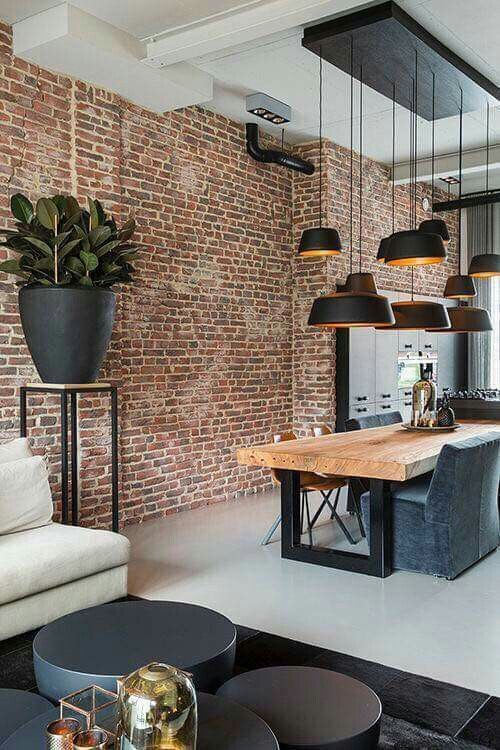 a bold red brick accent wall adds an industrial feel and makes the space more interesting