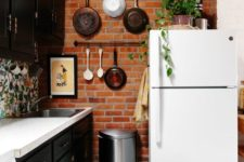 24 make your kitchen more interesting with a red brick accent wall that contrasts your cabinets