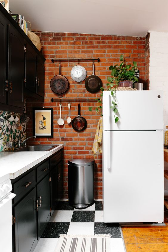 make your kitchen more interesting with a red brick accent wall that contrasts your cabinets