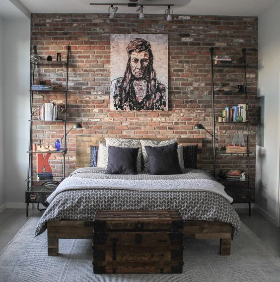 highlight your rustic meets industrial style with a red brick accent wall at the headboard