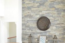 28 this elegant vintage space is spruced up with a stone accent wall that highlights the roof shape