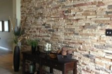 29 make your entryway special and interesting with a stone accent wall, which can be faux or real