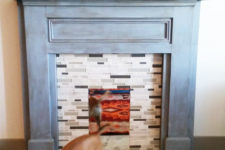 DIY faux brick fireplace with a faux mantel of wood