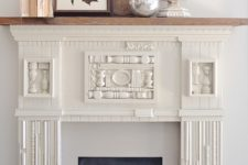 DIY elegant and refined faux mantel clad with scrap wood