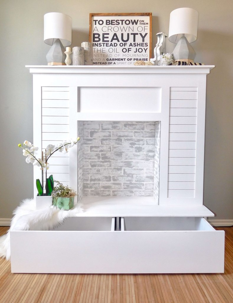 DIY faux fireplace with a large storage drawer