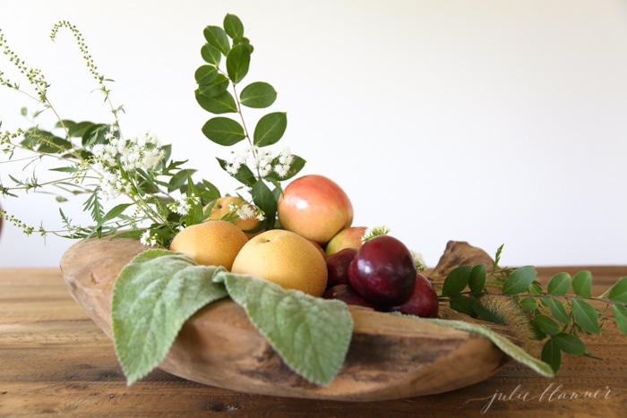 DIY fruits, moss, greenery arrangement in a wood bowl (via julieblanner.com)