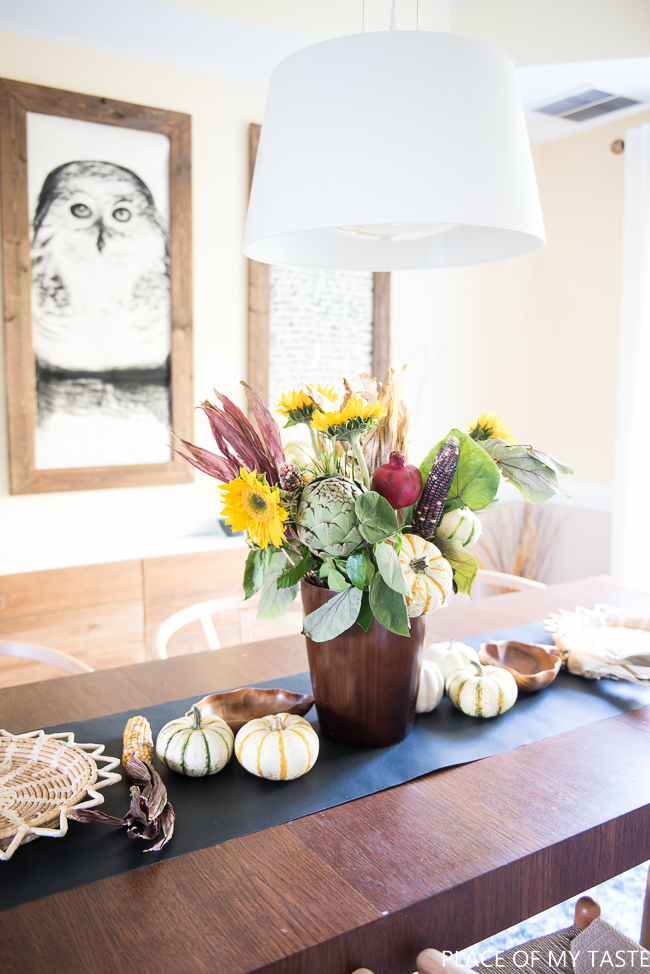 DIY rustic fall centerpiece with corn, corn huskspumpkins, artichokes and sunflowers (via placeofmytaste.com)
