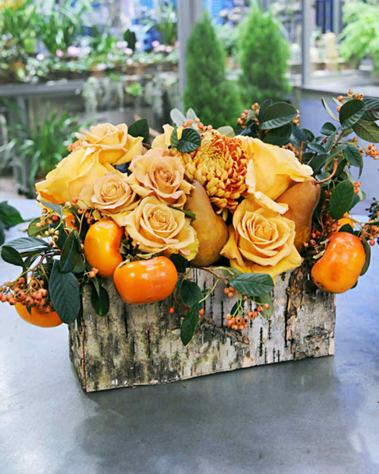 DIY orange-toned arrangement with greenery in a birch vessel (via www.marthastewart.com)
