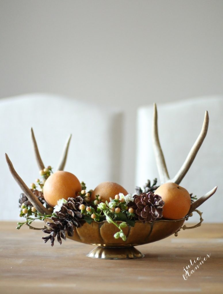 DIY woodland-inspired centerpiece with antlers, pinecones and apples (via julieblanner.com)