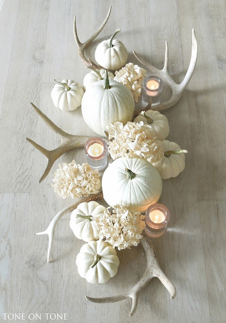 DIY elegant white rustic centerpiece with antlers and pumpkins (via toneontoneantiques.blogspot.com)