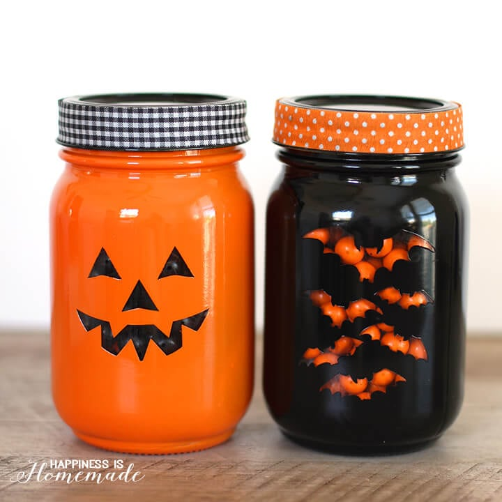 DIY painted and stenciled in orange and black with bright lids (via www.happinessishomemade.net)