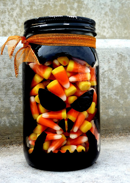 DIY skull and bones painted treat jar for Halloween (via www.sassysanctuary.com)