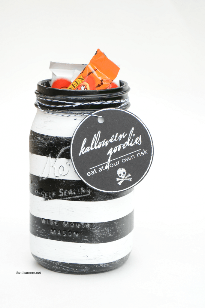 DIY black and white Halloween treat jars with tags (via www.theidearoom.net)