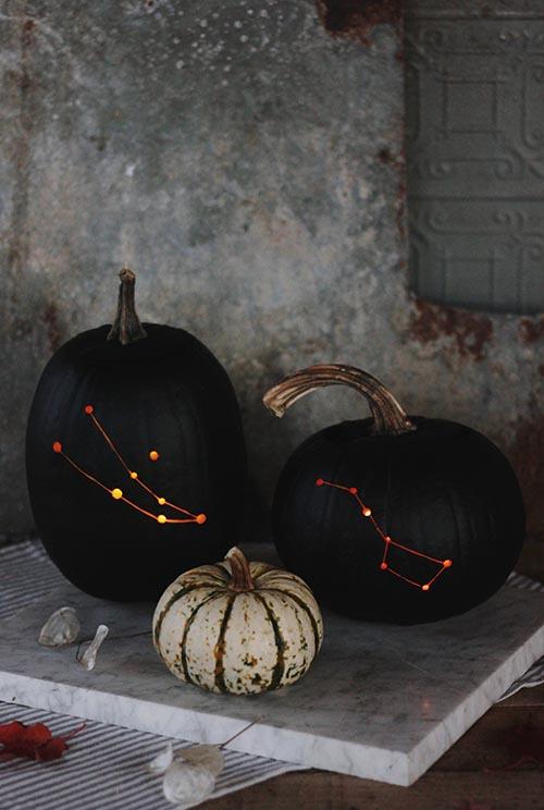 DIY refined black and orange drilled pumpkins (via www.designsponge.com)