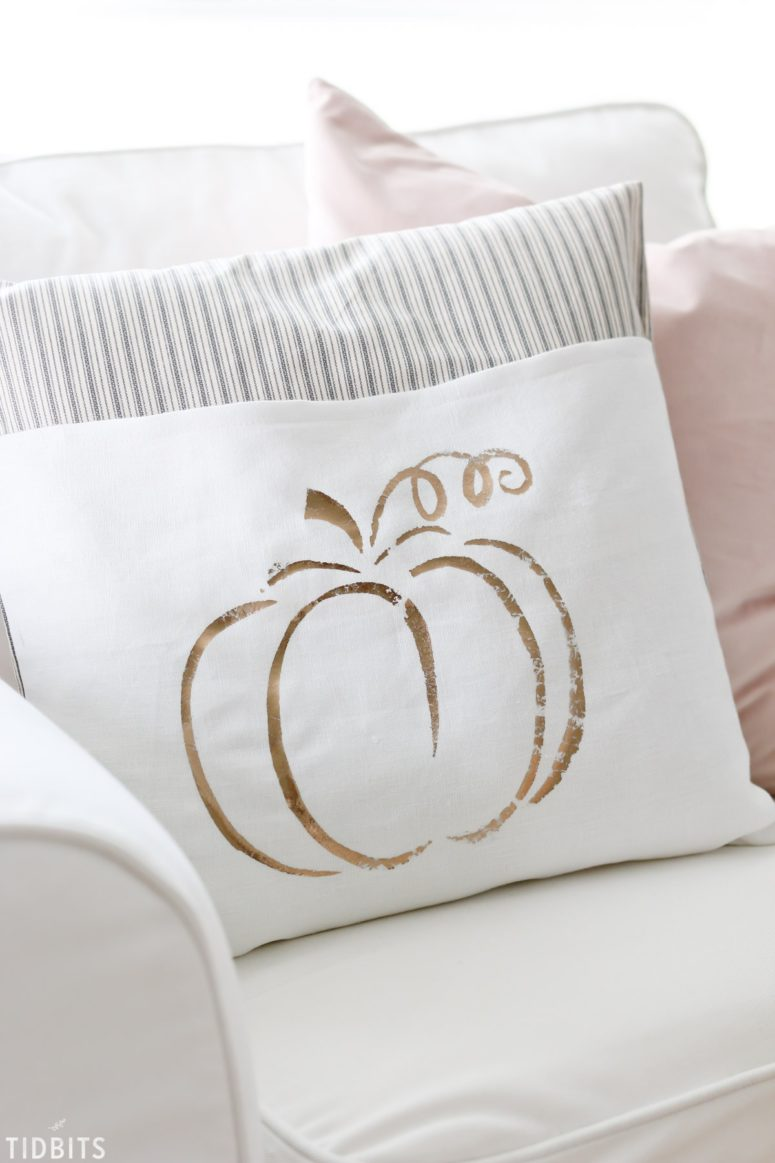 DIY pillows with metallic paint words (via www.tidbits-cami.com)