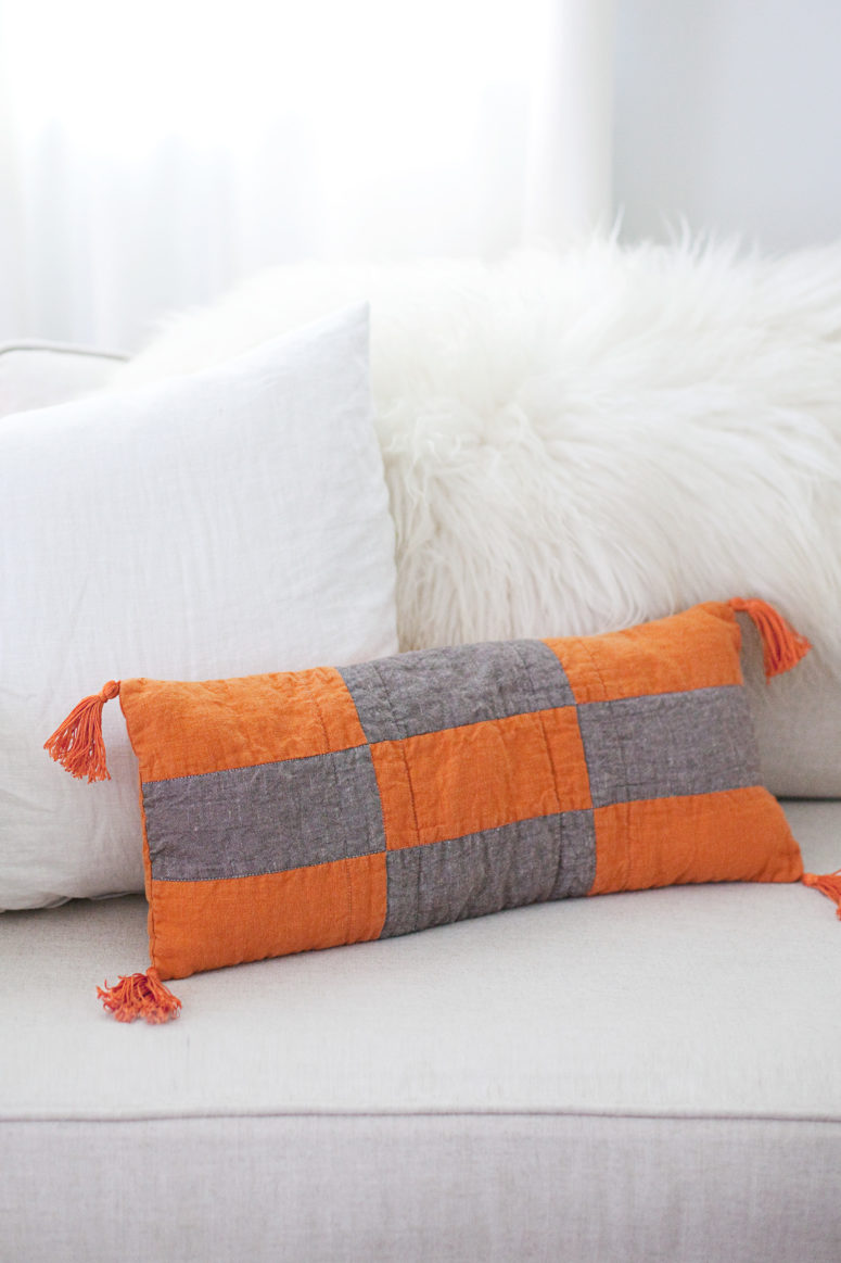 DIY modern patchwork pillow in grey and orange (via abeautifulmess.com)