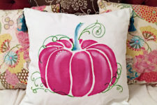 DIY pink pumpkin pillow with tassels on corners