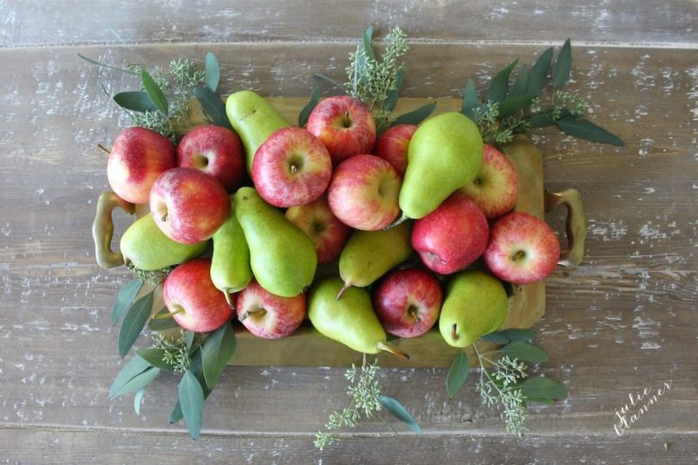 DIY simple fall centerpiece of pears, apples and eucalyptus (via julieblanner.com)