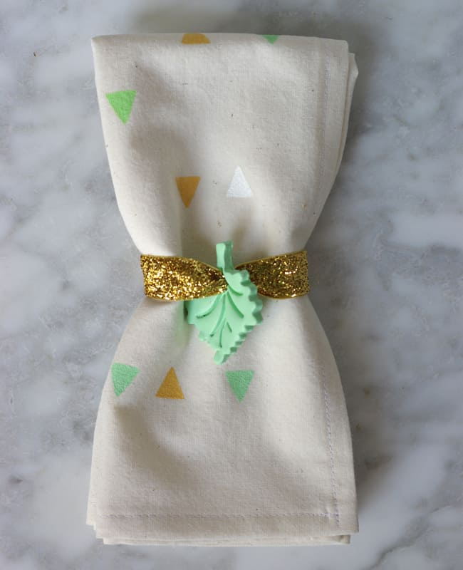 DIY pastel clay leaf and gold glitter napkin rings (via helloglow.co)