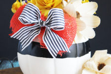 DIY contrasting pumpkin centerpiece with a large bow
