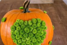 DIY orange pumpkin dotted with green mums