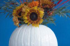 DIY faux pumpkin vase with a faux floral arrangement
