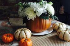 DIY faux pumpkin vase with a white fresh flower arrangement