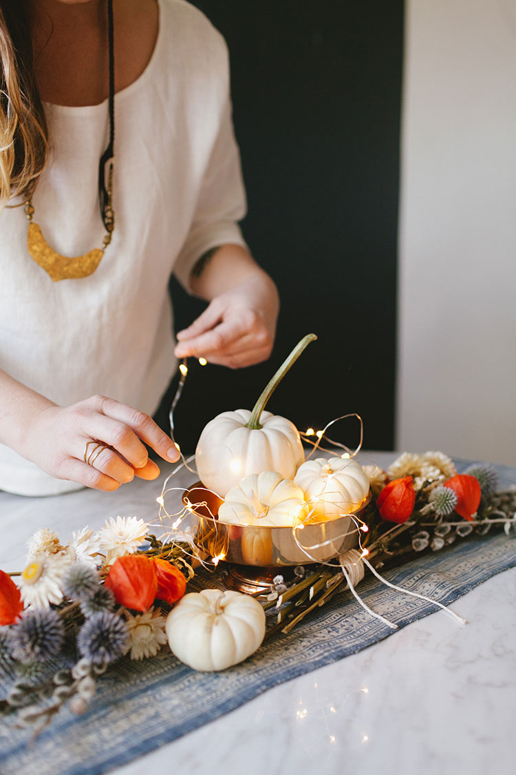 DIY dried blooms and pumpkins in a bowl with LEDs centerpiece (via jojotastic.com)